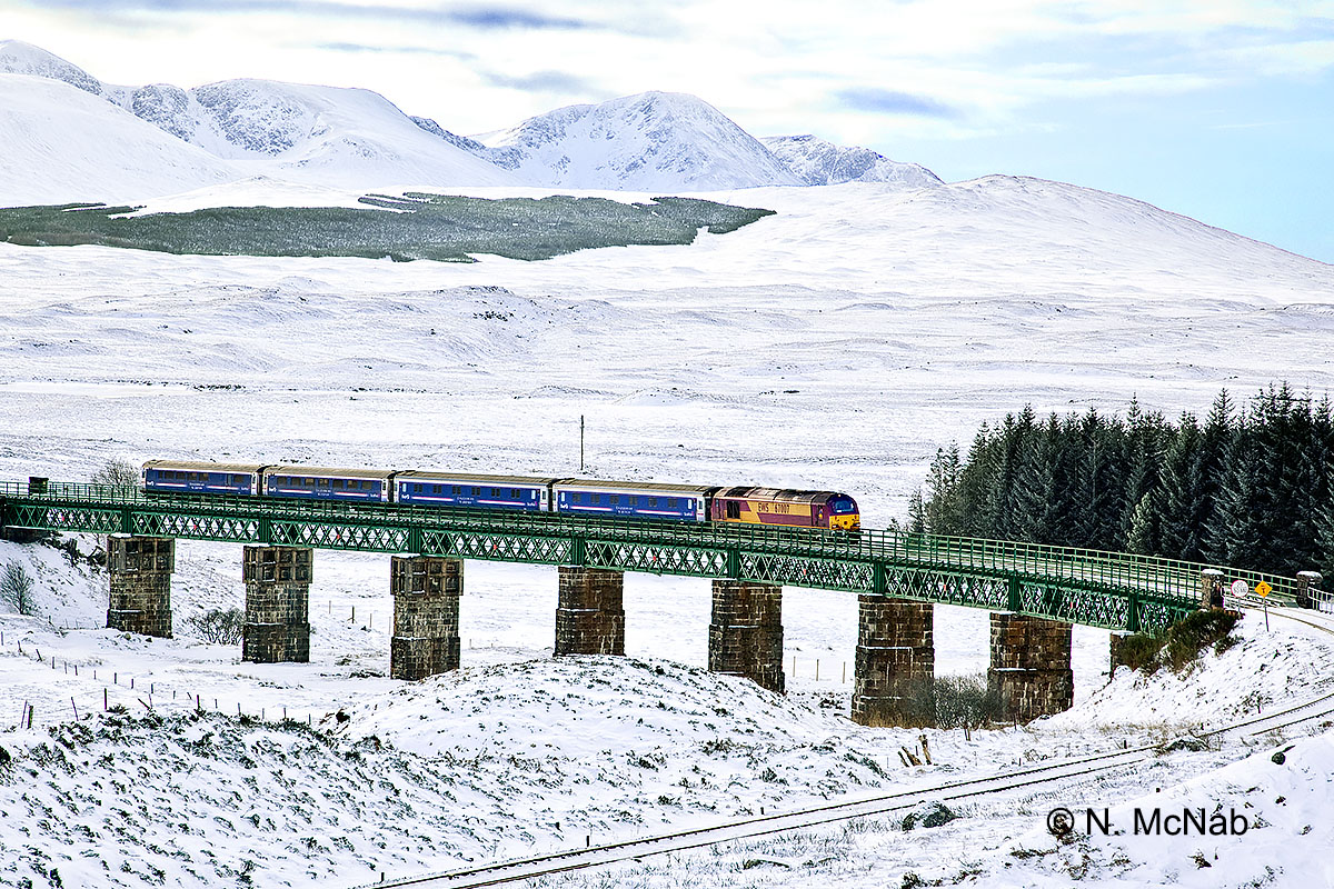 A Mid Winter Morning And The London Fort William Caledonian Sleeper Train Has Just Left Rannoch Station As It Crosses Viaduct