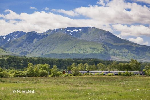 The Mallaig/Fort William to Glasgow service just east of Roybridge with Aonach More behind.