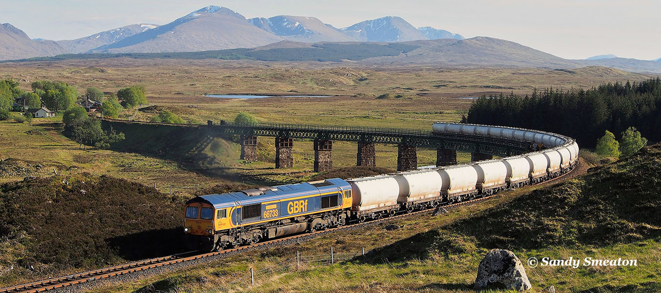Class66 heads an Alumina train to Fort William, crossing the Rannoch Viaduct on a June evening.